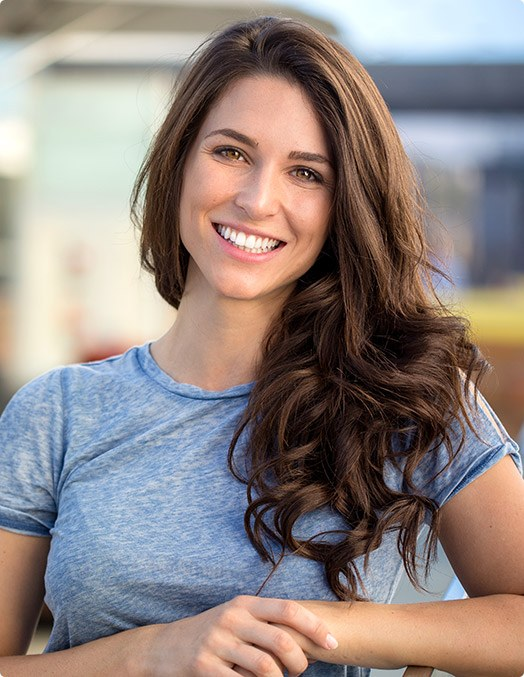 woman smiling in blue t-shirt