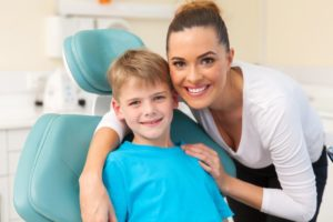 mother posing with son at dentist