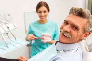 gray-haired man visiting his dentist for seniors in Leawood